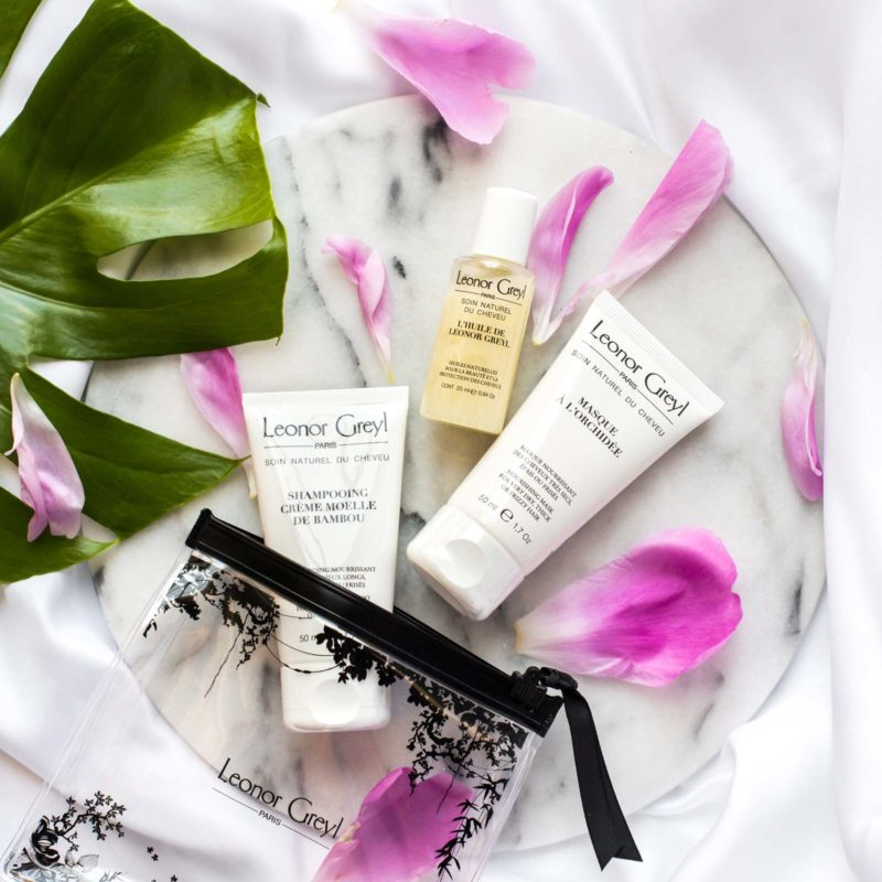 Leonor Greyl Luxury Travel Kit for Dry, Thick or Frizzy Hair with flower petals