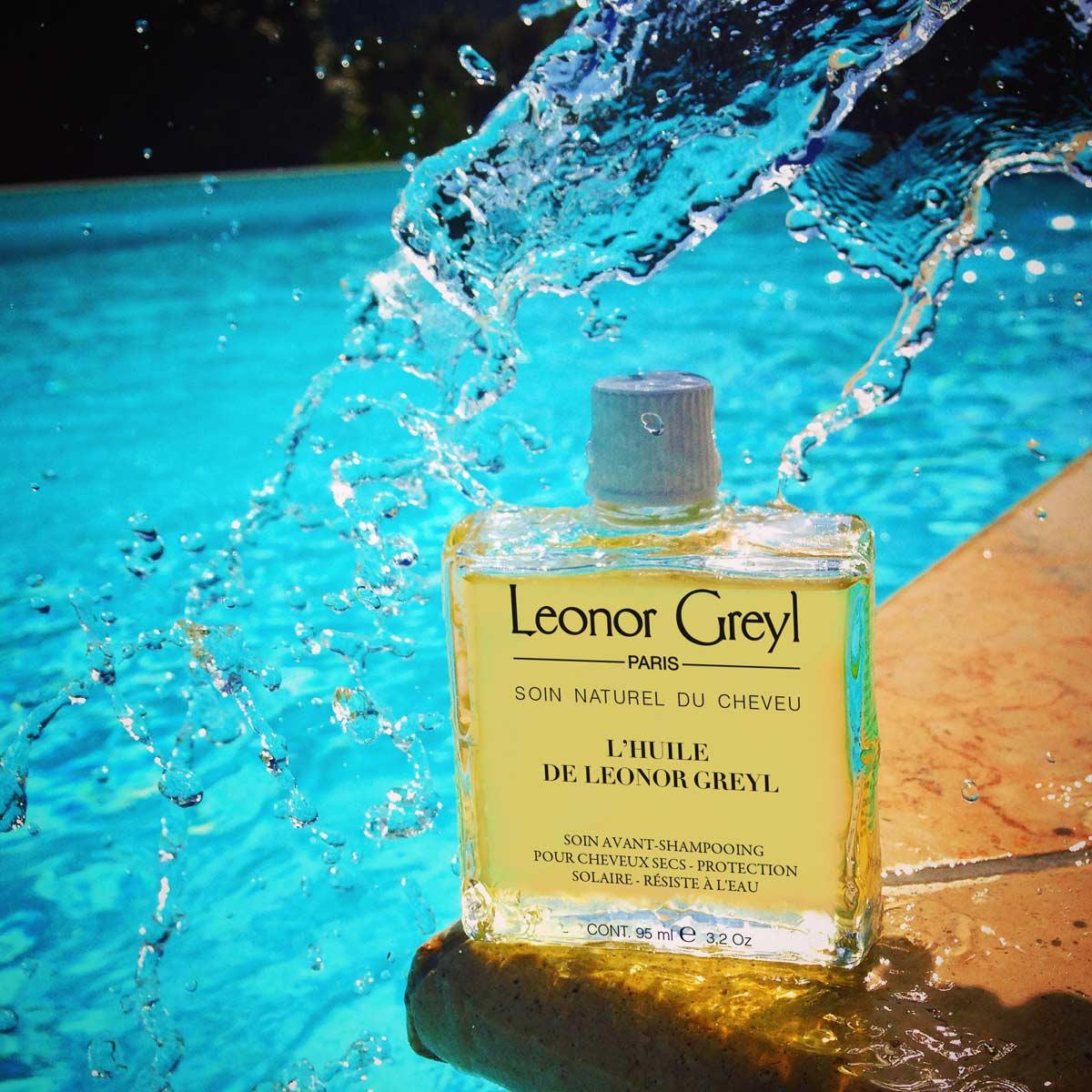 l'huile de leonor greyl next to pool