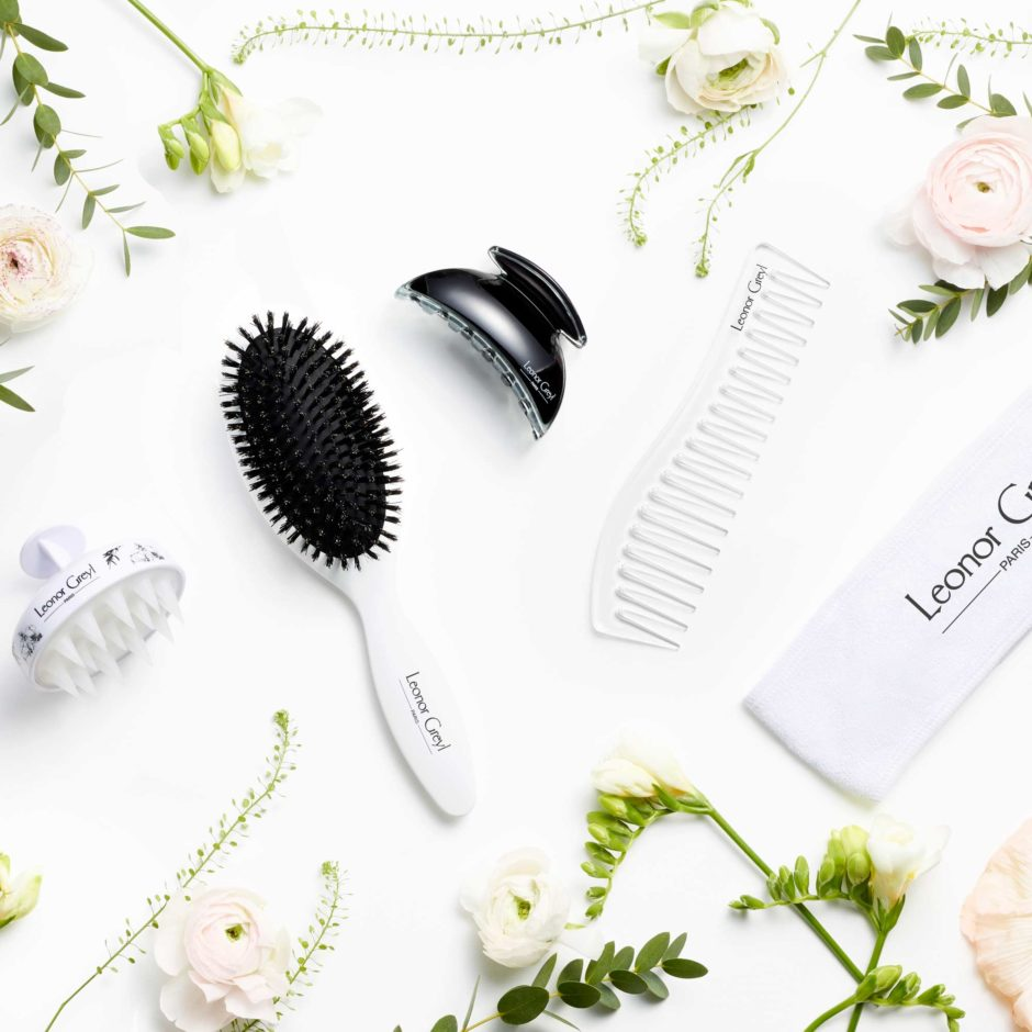 luxury hair accessories amongst flowers and greenery